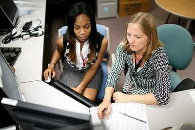 Carleen Njoku (on left; mentor Dr. Meghan Underhill, Phyllis F. Cantor Center for Research in Nursing and Patient Care Services)