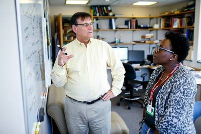 CURE Student Christina Marcelus (right; mentor Dr. James DeCaprio)